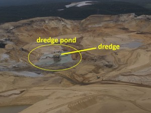 Dredge, dredge pond and large cleared area.